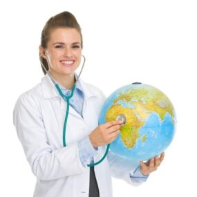 Female practitioner in white lab coat holding blue Stethoscope on a globe of the world for the Masters of global medicine program at Cherubino Health Center