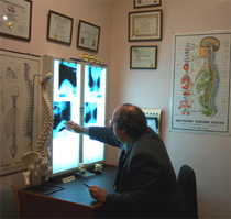 Dr Ron Cherubino evaluating xrays on viewbox at Cherubino Health Center