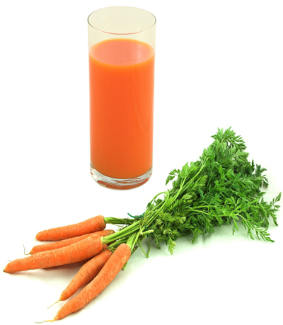 Photo Of A Glass Of Raw Carrot Juice With Raw Carrots In The Foreground Containing Live Enzymes
