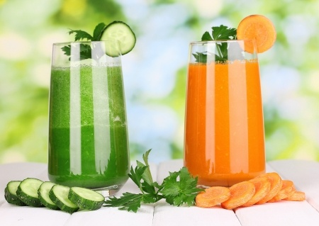 Photograph of two glasses raw carrot juice