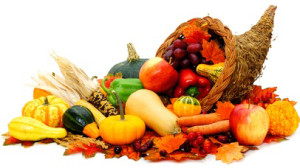 Photograph of a straw cornucopia with a plethora of fruits, vegetables and gourd