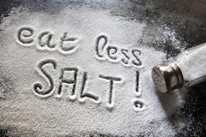 table salt with eat less salt! written in it