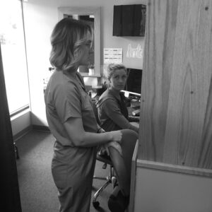 Dr Chis and Nicole at the front Desk of Cherubino Health Center